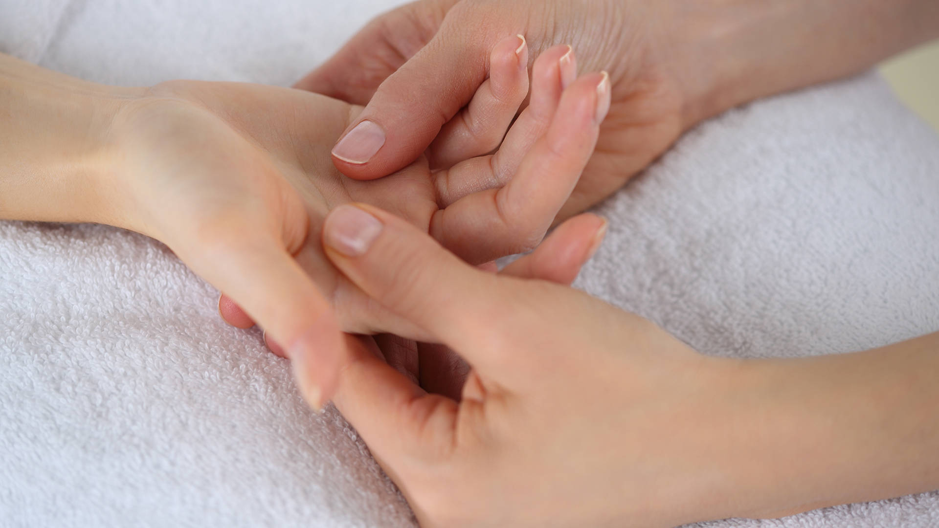 Palm massage treatment at The Essex Golf and Country Club