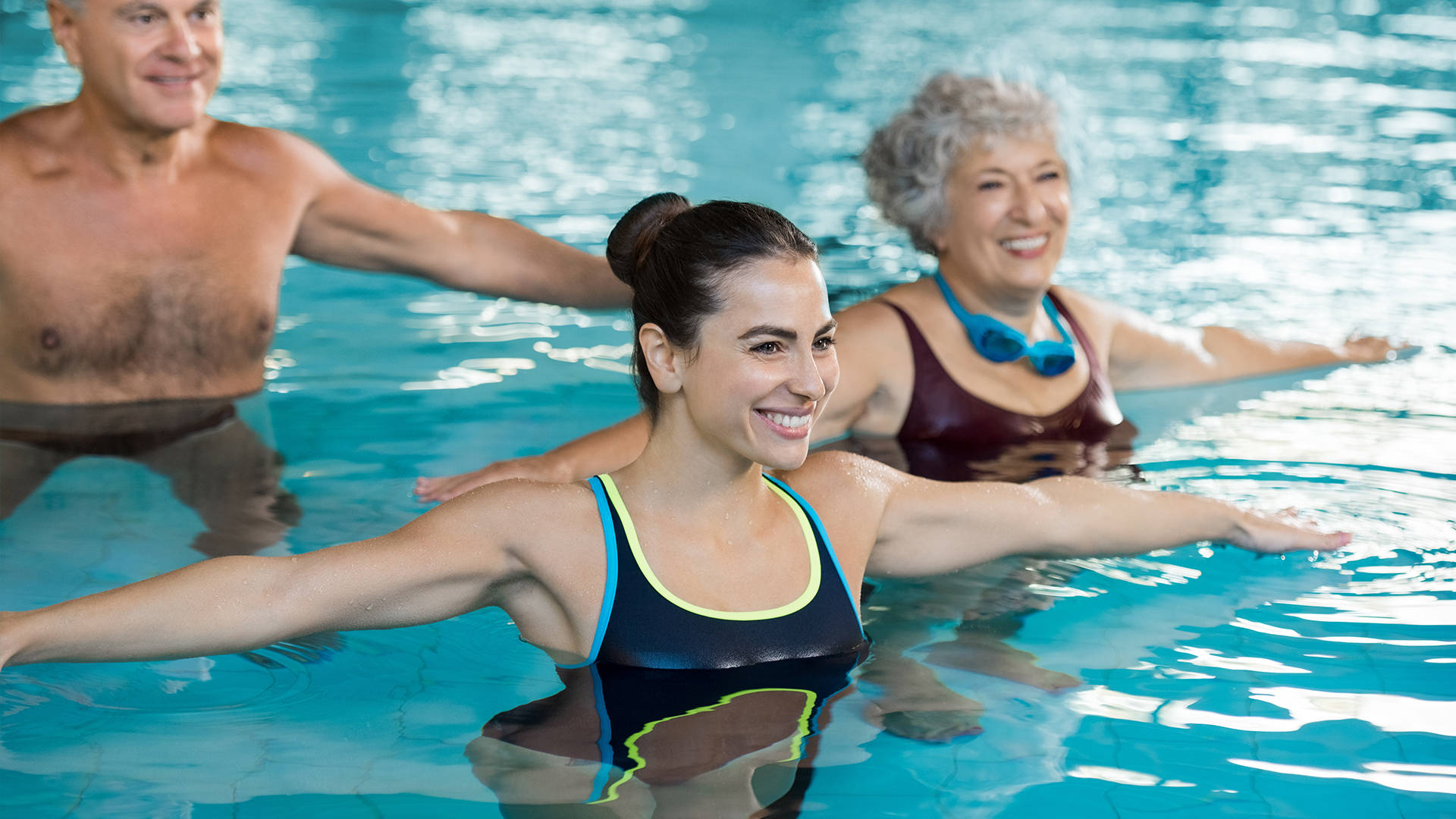 Two ladies enjoying an aqua class in The Essex's swimming pool
