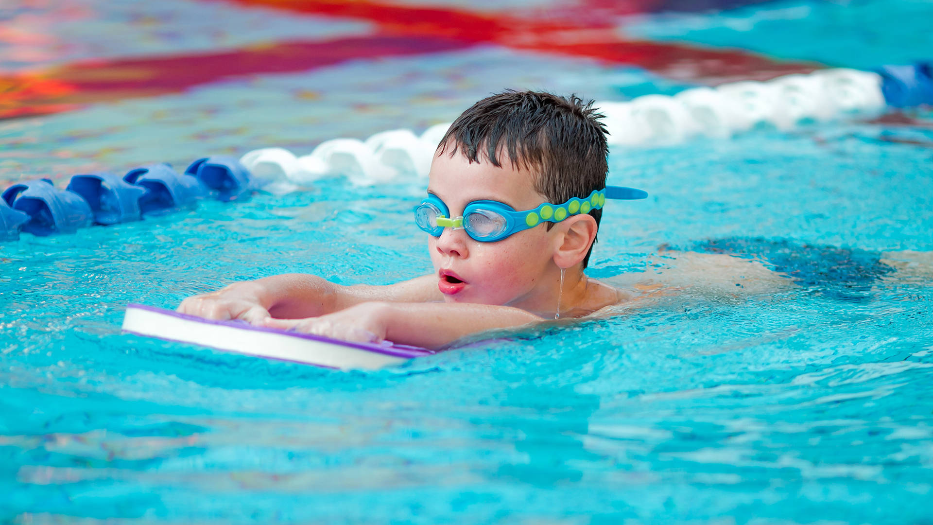 A child learning to swim during a swimming lesson in The Essex's swimming pool